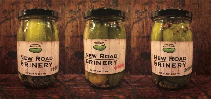 3 pickle jars against wood background